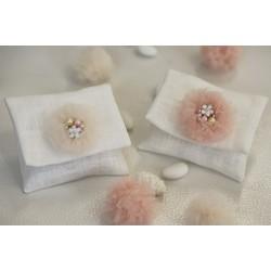 Bustina di lino con ponpon gioiello Cipria confezionata