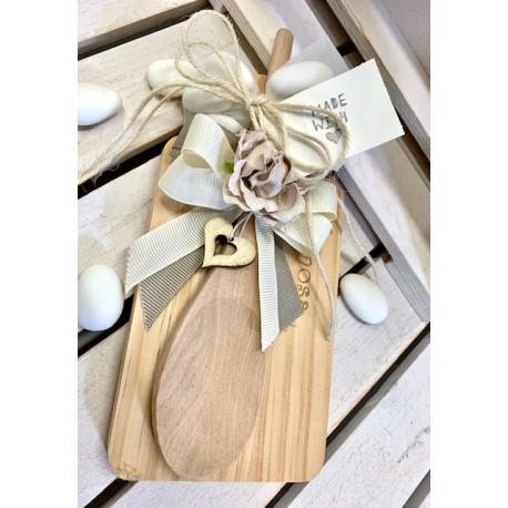 Barattolo di vetro con vassoietto e cucchiaio di legno confezionato