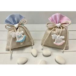 Sacchetto vuoto di tessuto bordo Rosa con fiocco di cordoncini con cuoricino e cavallo a dondolo di gesso